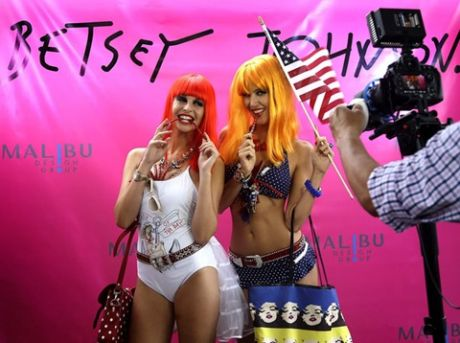Models pose during a Betsey Johnson swimwear show. (Lynne Sladky/Associated Press)