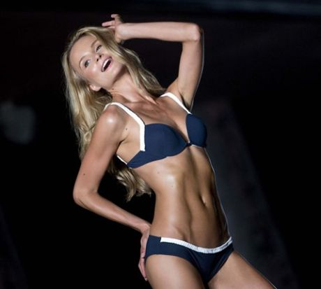 A model walks the runway wearing Barraca Chic swimwear. (J Pat Carter/Associated Press)