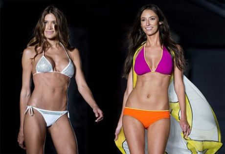 Models walk the runway wearing Barraca Chic swimwear. (J Pat Carter/Associated Press)